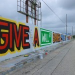 """ABOVE """"Give A Wall Street Banker Enough Rope And He Will Hang Himself"""" New Mural In Miami"""