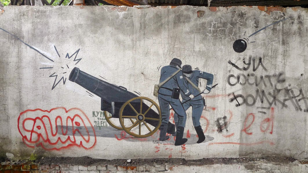 """Escif paints """"Karma"""" on the streets of Kronstadt in Russia"""