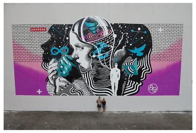 Dourone paints a new mural in Louvain La Neuve, Belgium