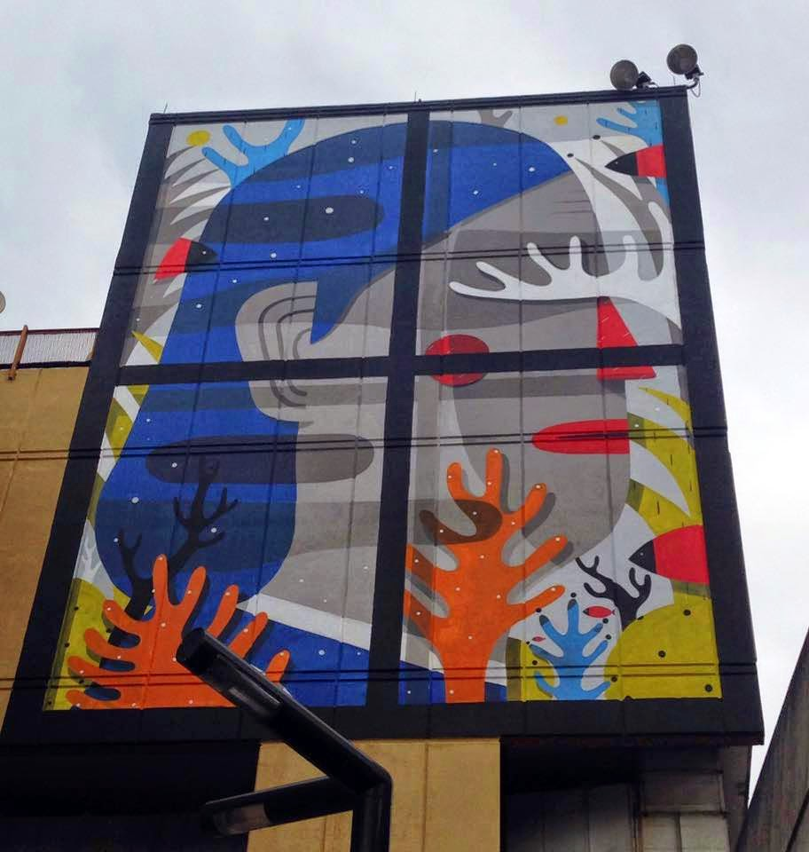 Agostino Iacurci paints a new mural for Los Muros Hablan in Bayamon, Puerto Rico