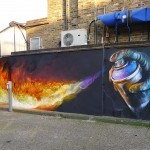 "Irony paints ""Burn"", a new mural in Camden, London"