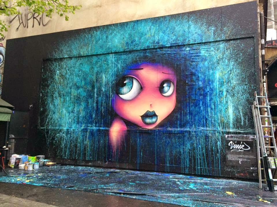 Vinnie paints a new street piece for Le Mur in Paris, France