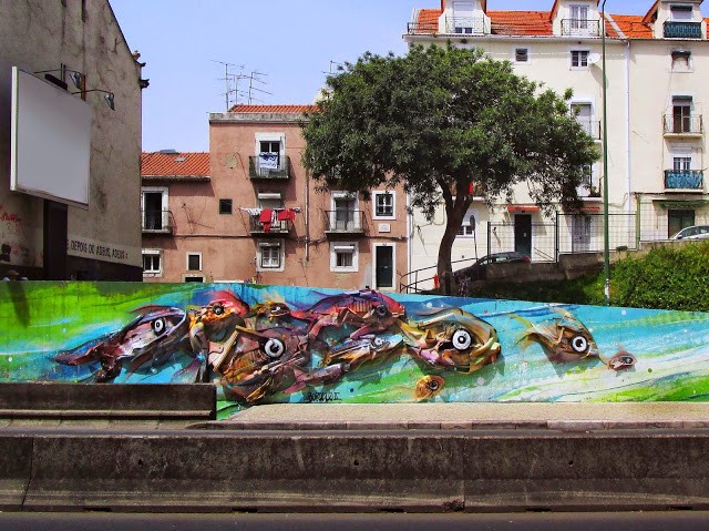 "Bordalo II builds ""Peixes d´Alcantara"", its newest installation in Lisbon, Portugal"