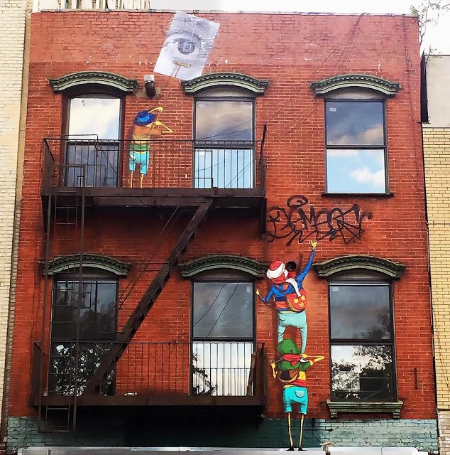 Os Gemeos & JR collaborate on a new piece in New York City