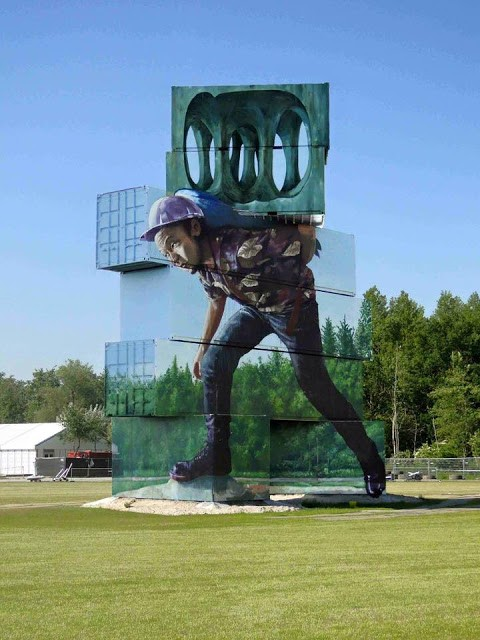 """Moving the Pointless Monument"", an incredible piece by Fintan Magee in Werchter, Belgium"