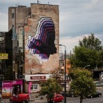 1010 paints a large black hole in Warsaw, Poland for Street Art Doping