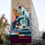 Nelio paints a large abstract piece in Venissieux, France