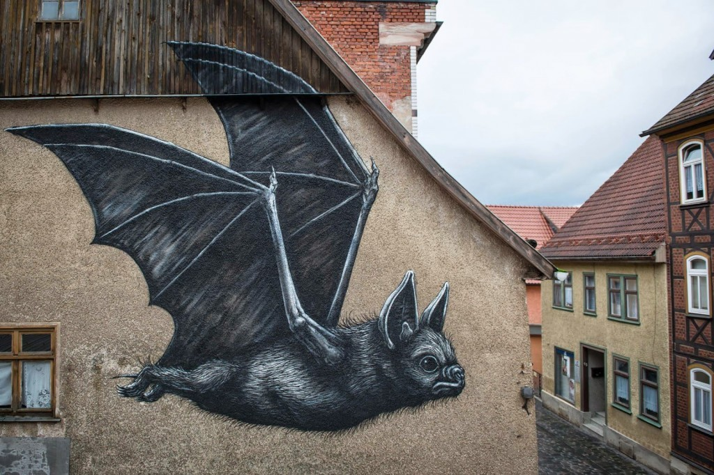 ROA paints a new piece in Schmalkalden, Germany for WallCome Festival