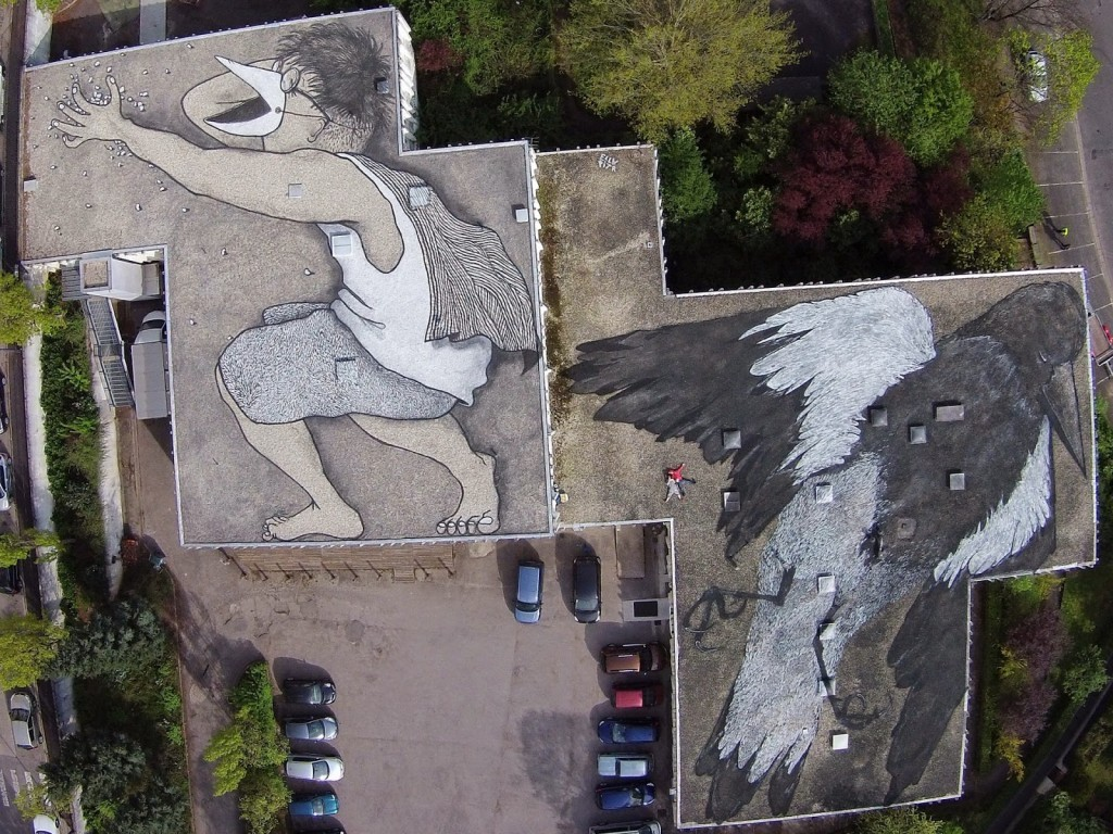 Ella & Pitr paint a giant rooftop piece in Saint-Etienne, France
