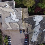 Ella & Pitr paint a giant rooftop piece in Saint-Etienne, France