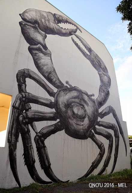 ROA paints a massive Coconut Crab in Papeete, Tahiti