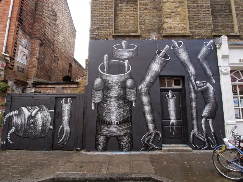 Phlegm paints a new mural on Hanbury Street in East London