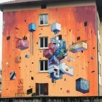 Etnik paints a new mural in Trento, North Italy