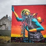 Deih XLF paints a large mural in Reykjavik, Iceland