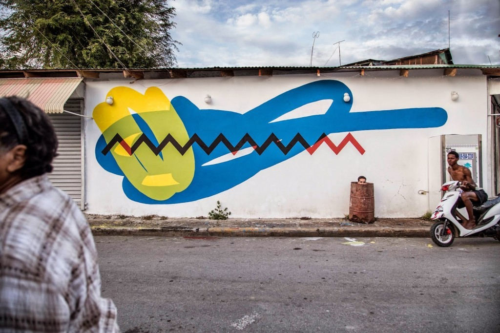 Elian paints a new piece for Artesano in Rio San Juan, Dominican Republic