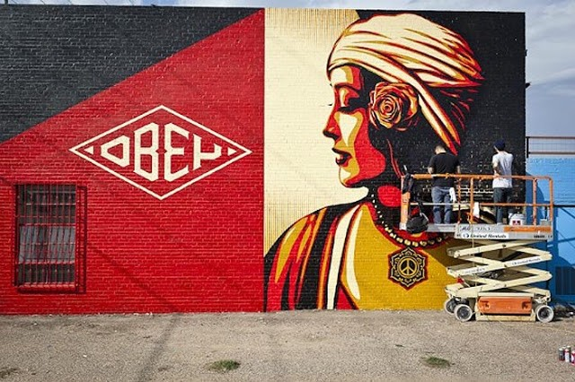 Shepard fairey rise above new mural in progress dallas for Dallas mural artists