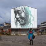 """Guido Van Helten paints """"Pooŋojorteq"""" in Nuuk, Greenland"""