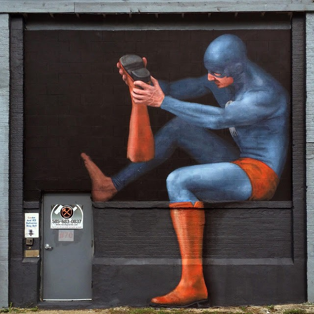 Andreas Englund paints a superhero in Rochester, USA