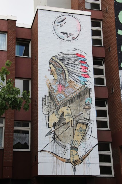 Word To Mother creates a new mural in Berlin, Germany