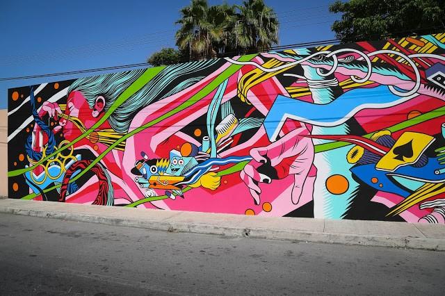 SeaWalls '15: Bicicleta Sem Freio creates a new piece in Cozumel, Mexico