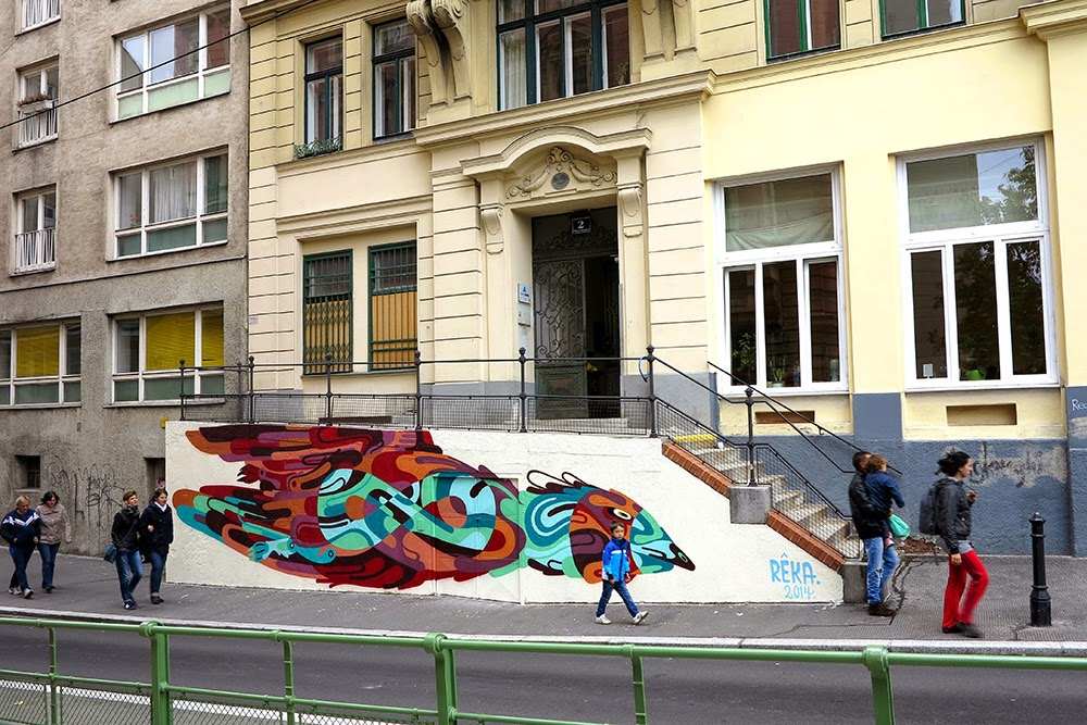 REKA paints a new street piece in Vienna, Austria