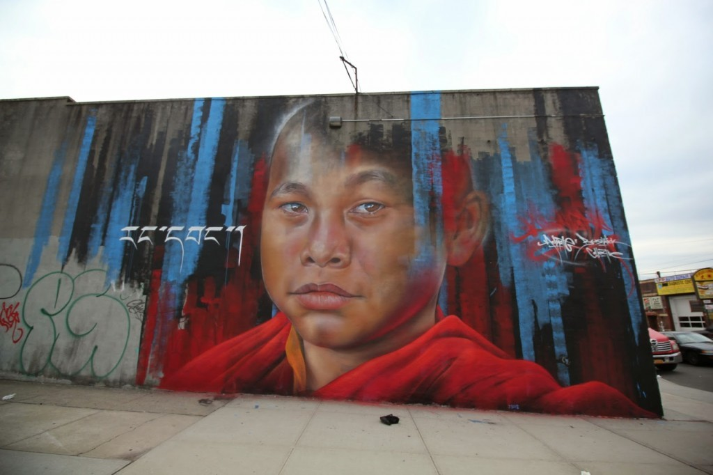 Adnate creates a new piece for The Bushwick Collective in New York City