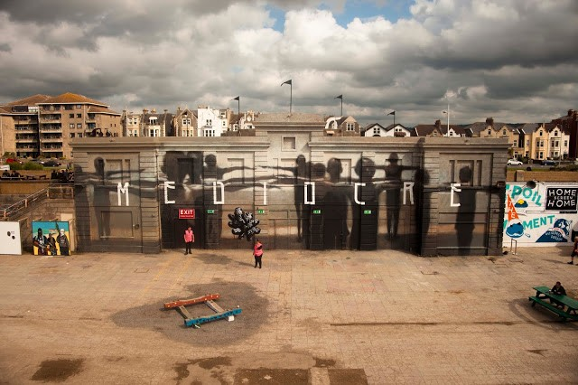 """Mediocre"", a new mural by Axel Void in Weston-Super-Mare, UK for Dismaland"