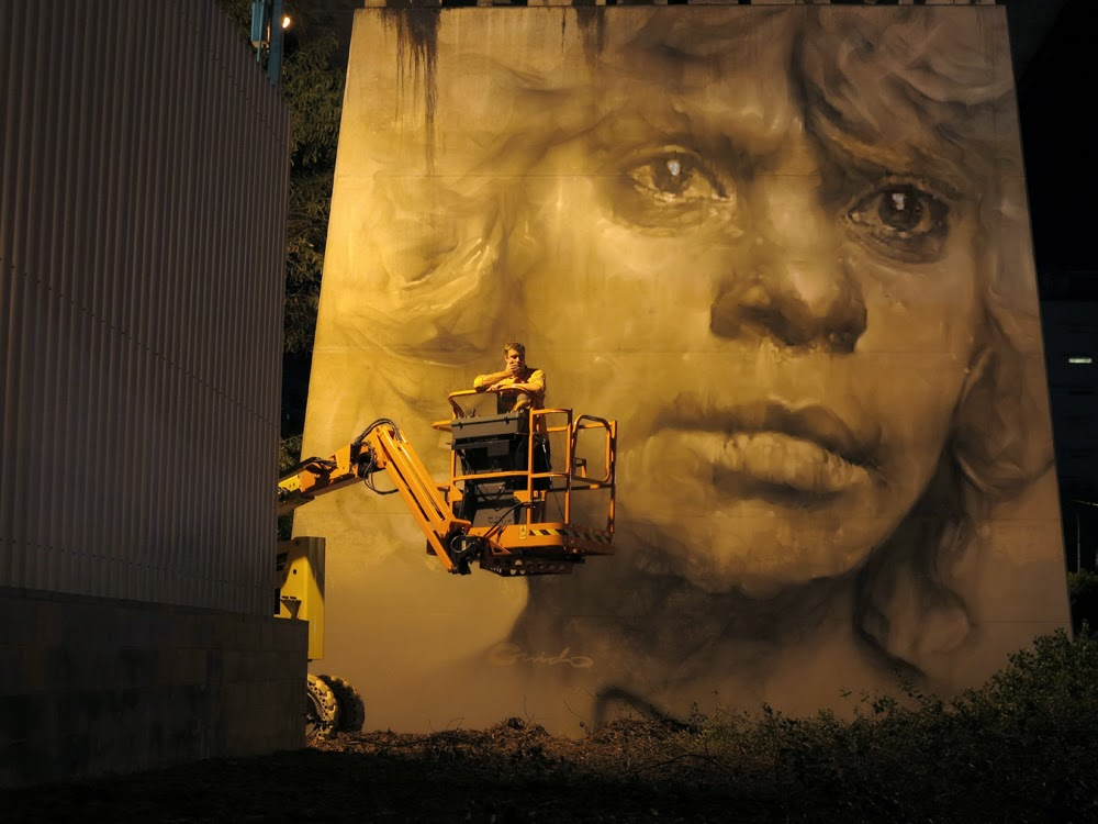 Guido Van Helten paints a new mural in Brisbane, Australia