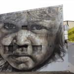 Guido Van Helten paints a new portrait in Redfern, Australia