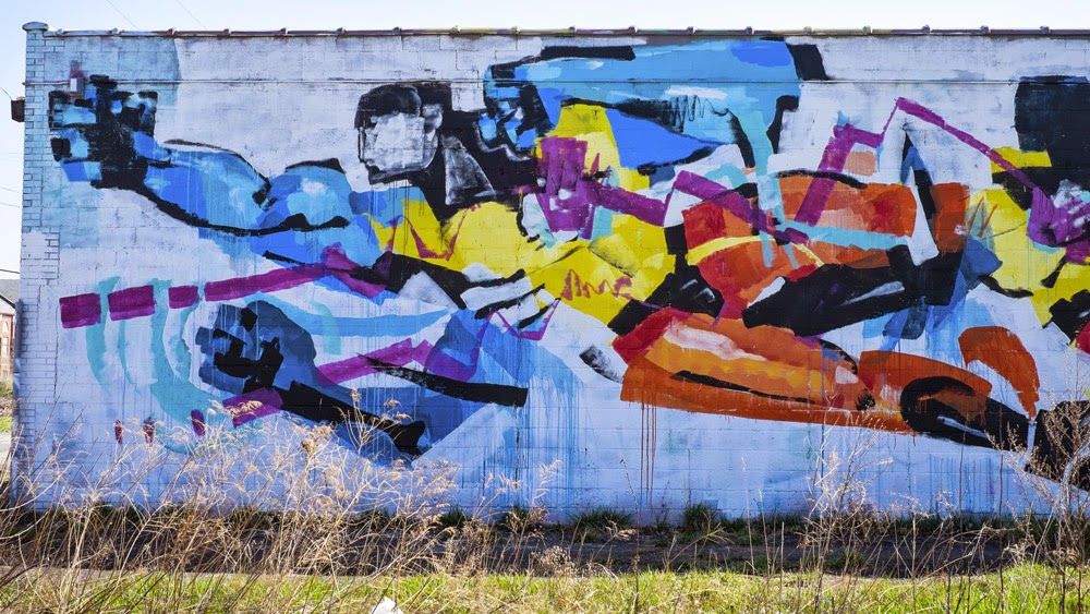 Anthony Lister paints a large mural in Detroit