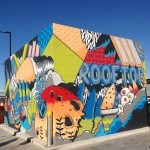 Brent Smith paints a mural at the Westfield Miranda Rooftop in Sydney