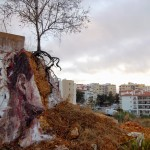 Borondo paints a striking new piece in Lagos, Portugal for ARTURb