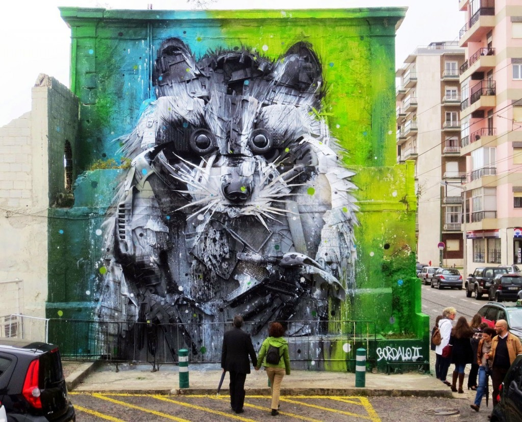 "Bordalo II creates ""Big Racoon"", a stunning street installation in Belem, Portugal"