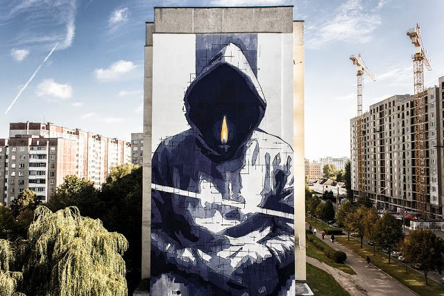 Ino paints a large new mural in Minsk, Belarus