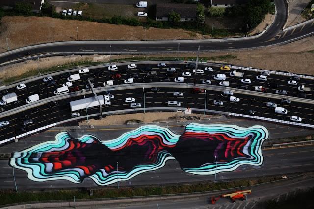 1010 paints a giant optical illusion in Paris, France