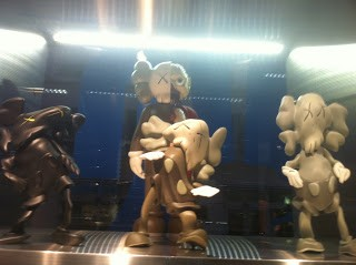 """KAWS x Robert Lazzarini  """"Distorted Companions"""" Available In Stock Now"""