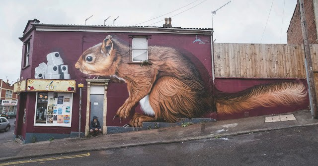 "Lonac paints ""Skinny Cap Thief"", his latest mural in Bristol, UK"