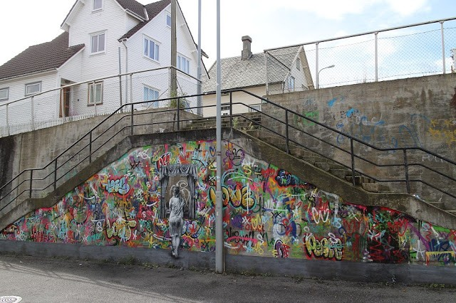 Martin Whatson paints a new mural in Stavanger for Nuart 2015