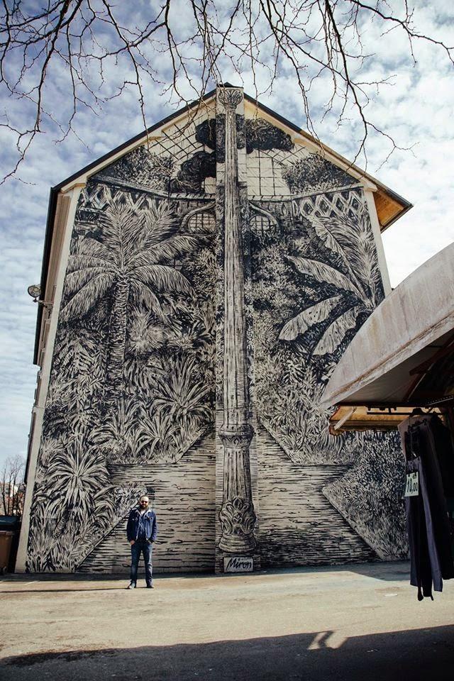 Miron Milic paints a large mural in Ljubljana, Slovenia