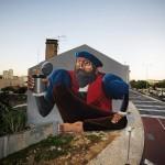 Nunca paints a new large mural in Lisbon
