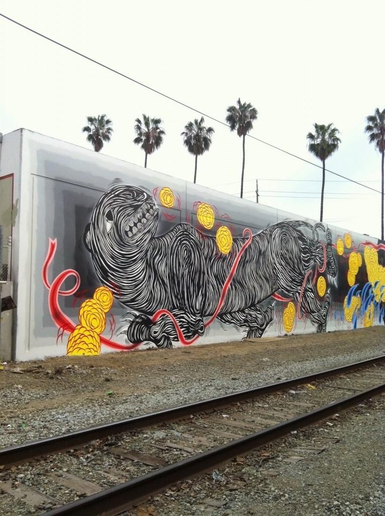 Andrew Schoultz paints a new mural in Santa Fe, California
