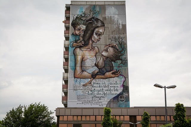 """If I Knew The World Ended Tomorrow, I'd Still Plant An Apple Tree"" a massive mural by Herakut in Berlin"