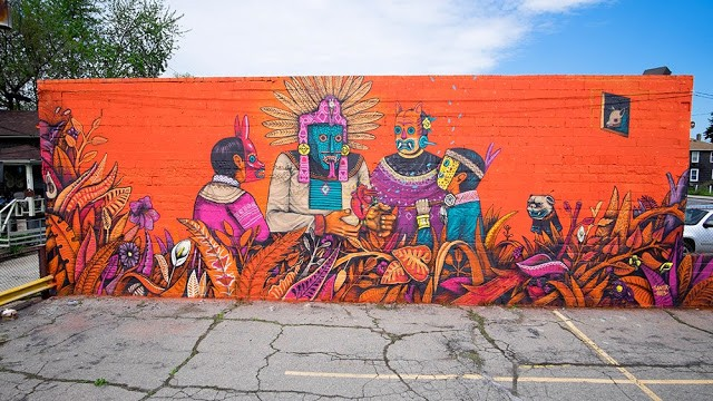 Saner paints a new mural during his art residency in Detroit