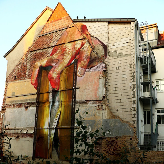"""Segregation"", a powerful mural by Case in Lutherstadt Wittenberg, Germany"