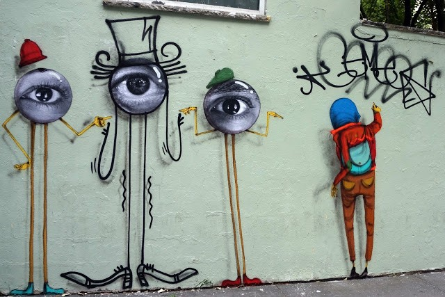 Os Gemeos, JR & Mr Andre collaborate on a street piece in New York City