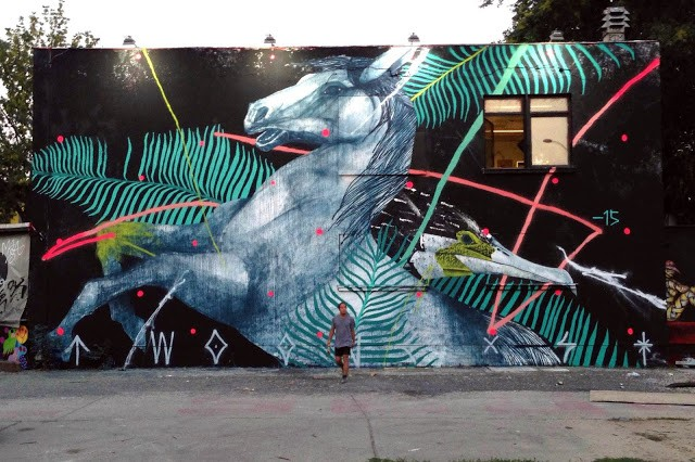 TWOONE unveils a large mural at Urban Spree in Berlin, Germany
