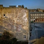 Vhils unveils a new mural for Urban Forms on the streets of Lodz, Poland