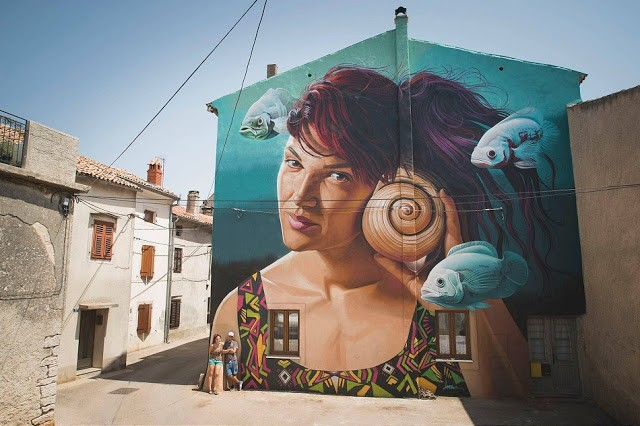 Lonac paints a photo realistic mural in Vodnjan, Croatia