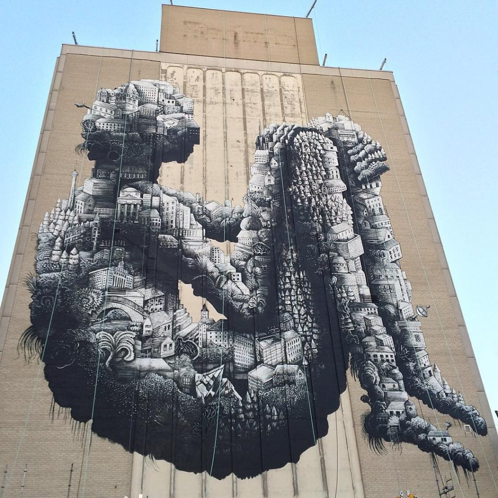 Phlegm paints a 12-storey building in Toronto, Canada
