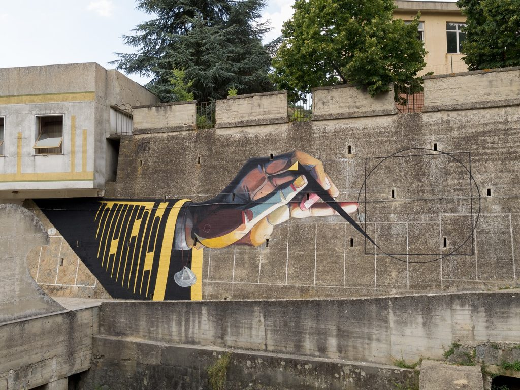 """The Artist as Saint Roch squaring the circle on a wall in Gerocarne"" by Basik in Italy"